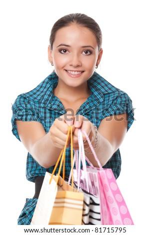 pretty woman gave bags for shopping, studio shot - stock photo
