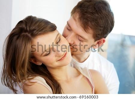 Pretty woman has pleasure from male kisses - stock photo