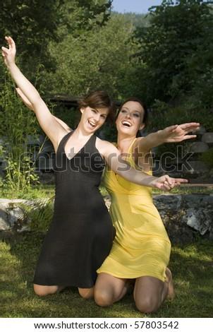Pretty woman having fun in the park - stock photo