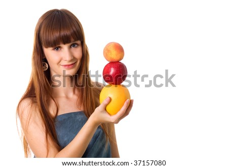 Pretty woman hold some fruits. Studio shot