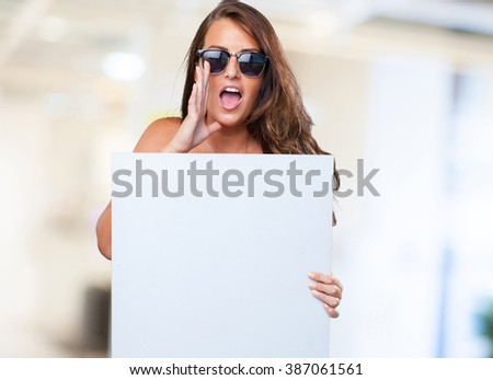pretty woman holding a banner - stock photo