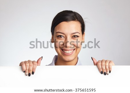 Pretty woman holding a billboard. - stock photo