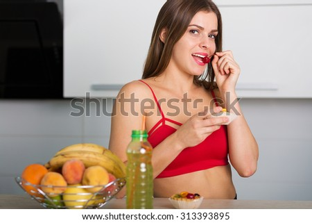 Pretty woman holding a cake and a cherry - stock photo