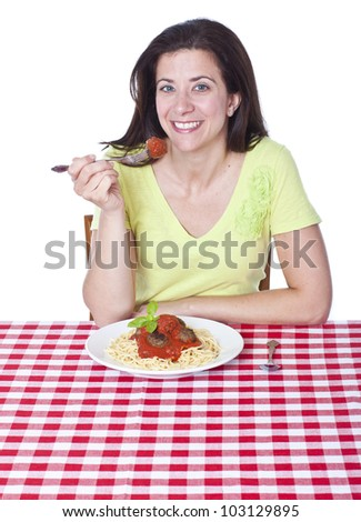 Pretty woman holding a fork with spaghetti portrait - stock photo