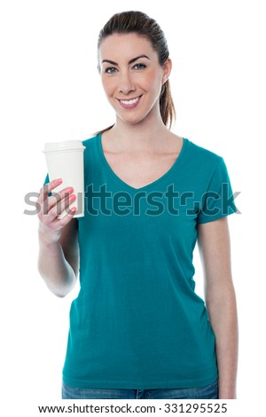 Pretty woman holding a paper mug