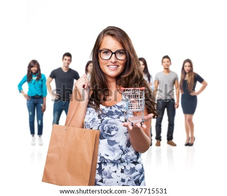 pretty woman holding a shopping cart - stock photo