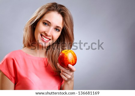 Pretty woman holding apple on her hand - diet concept - stock photo