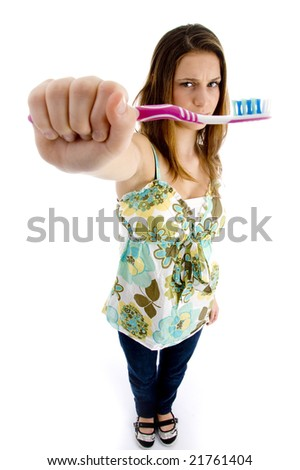 pretty woman holding brush with white background - stock photo