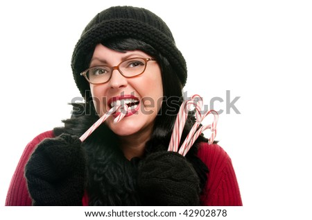 Pretty Woman Holding Candy Canes Isolated on a White Background.