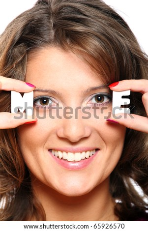 Pretty woman holding letters m and e close to her face - stock photo