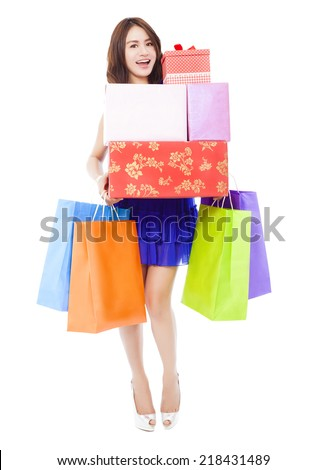 pretty woman holding shopping bags and gift boxes over white background