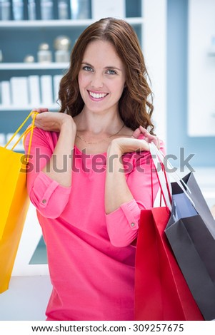 Pretty woman holding shopping bags at the pharmacy