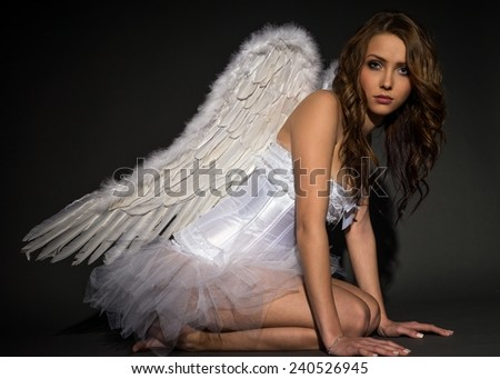 pretty woman in a angel costume / Angel - stock photo