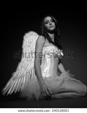 pretty woman in a angel costume in black and white / Angel