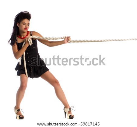Pretty woman in a black dress in a tug a war with authority - stock photo