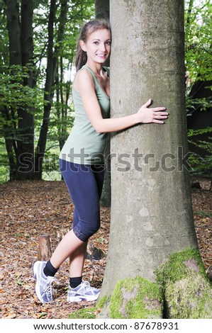 pretty woman in a forest - stock photo