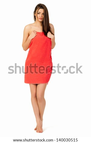 Pretty woman in a red towel is a full figure in a white background isolated - stock photo