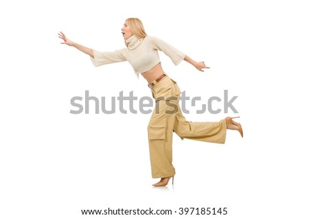 Pretty woman in beige trousers isolated on white - stock photo
