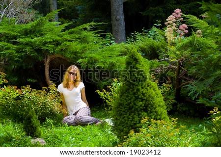 Pretty woman in botanic garden - stock photo
