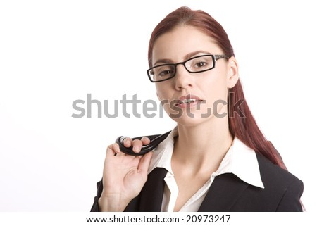 Pretty woman in business attire with her purse sling over her shoulder - stock photo
