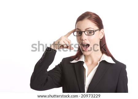 Pretty woman in business suit pointing at her head