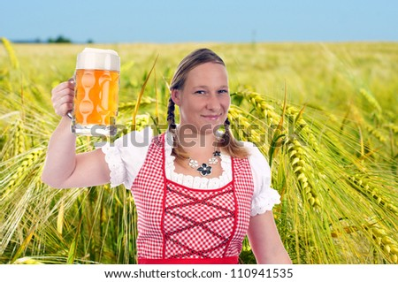 pretty woman in dirndl and Pint - stock photo