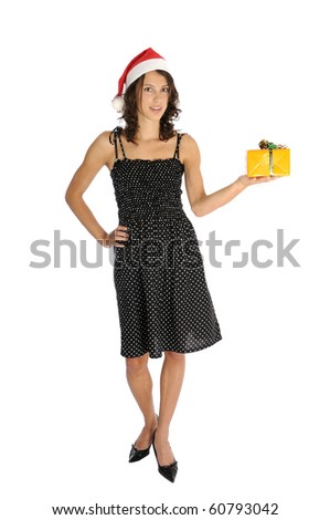Pretty woman in dress holding christmas present - stock photo