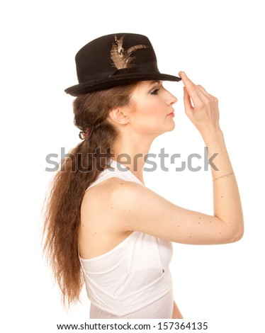 Pretty woman in hat with bird's feather, isolated