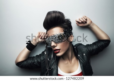pretty woman in leather jacket - stock photo