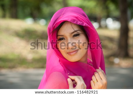 Pretty woman in Pink Indian clothes is posing . - stock photo