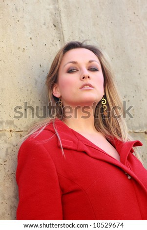 pretty woman in  red coat - stock photo