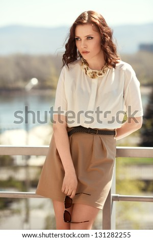 Pretty woman in summer dress outdoors - stock photo