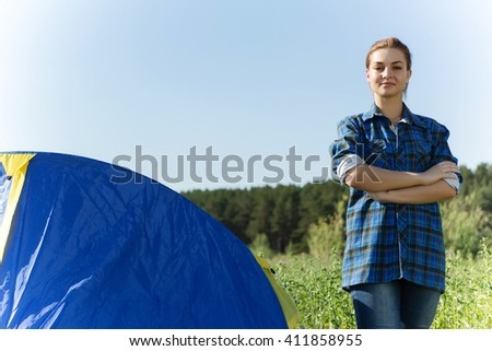 Pretty woman in summer forest - stock photo