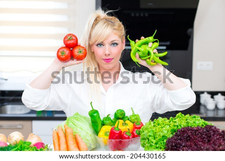 Pretty Woman in the kitchen - stock photo