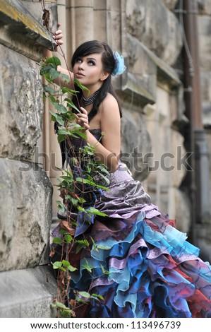 Pretty woman in violet wedding dress - stock photo
