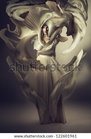 pretty woman in white dress on wind - stock photo
