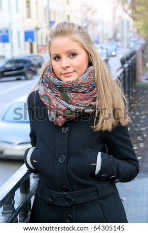 Pretty woman in winter dress in big city