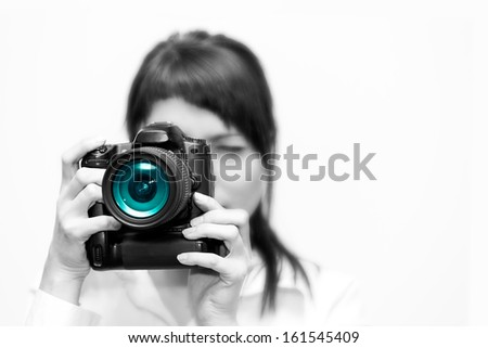 Pretty woman is a professional photographer with camera - stock photo
