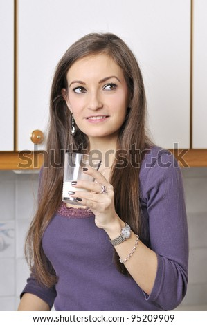 pretty woman is drinking milk - stock photo