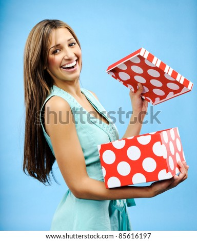 Pretty woman is happy to receive a gift for Christmas - stock photo