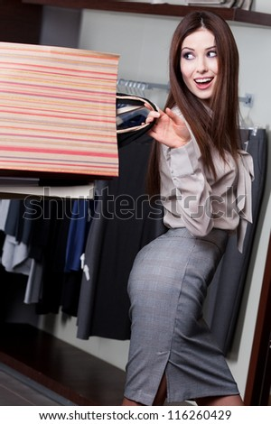 Pretty woman is so happy that made this bargain - stock photo