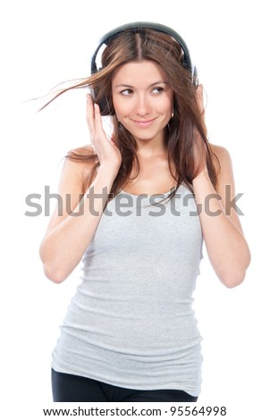 Pretty woman listening and enjoying music in headphones earphones, smiling, laughing and looking in camera isolated on a white background - stock photo