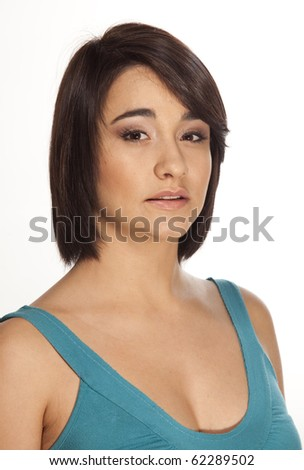 Pretty woman looking straight into the camera with a serious expression on white background. - stock photo