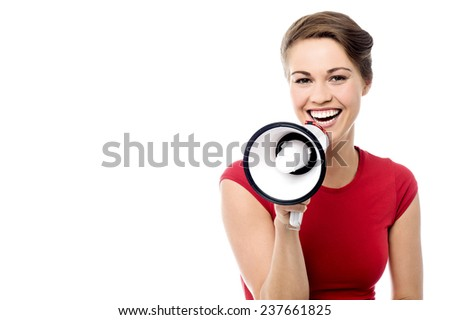Pretty woman making announcement with loudhailer - stock photo