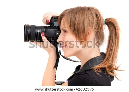 Pretty woman making photo with professional camera. Side view over white background - stock photo