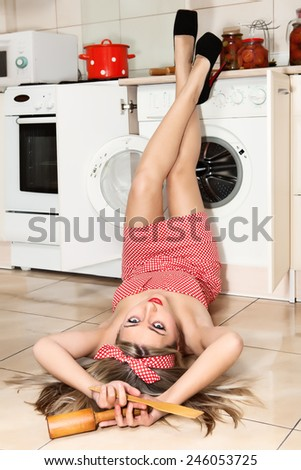 Pretty woman near washing machine.  - stock photo