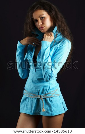 pretty woman of the brunette, on black background - stock photo