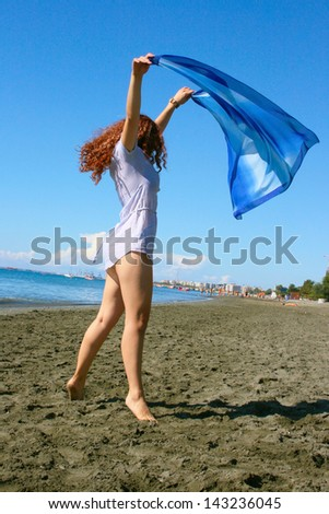 Pretty woman on beach in Limassol, Cyprus. - stock photo