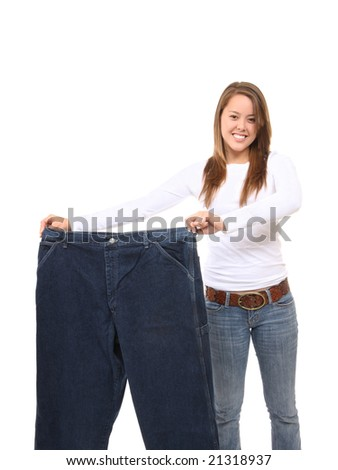 Pretty Woman on Diet Showing Weight Loss - stock photo