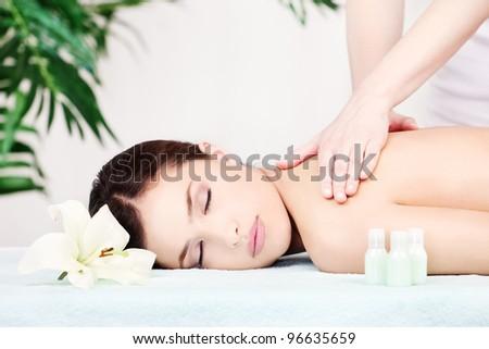Pretty woman on shoulder massage in salon - stock photo